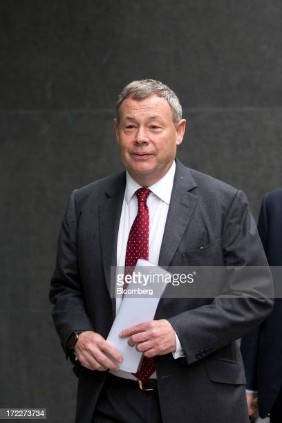 Ian Hannam former global chairman of equity capital markets at JPMorgan Chase Co carries papers as he arrives to give evidence at the High Court in...