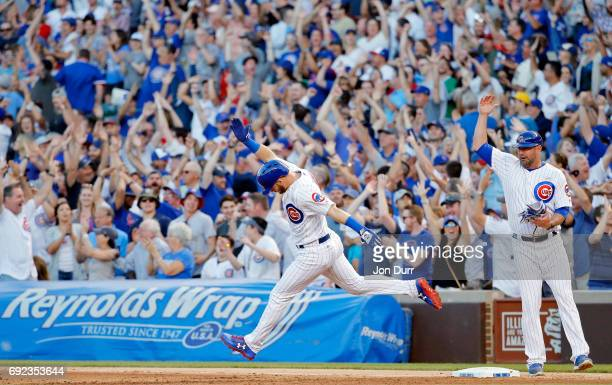 Ian Happ of the Chicago Cubs celebrates as he rounds the bases after hitting a three run home run against the St Louis Cardinals during the fourth...