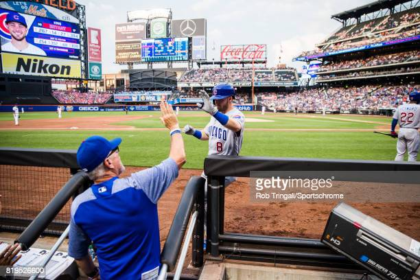 Ian Happ of the Chicago Cubs gets greeted by his teammates after hitting a grand slam home run during the game against the New York Mets at Citi...