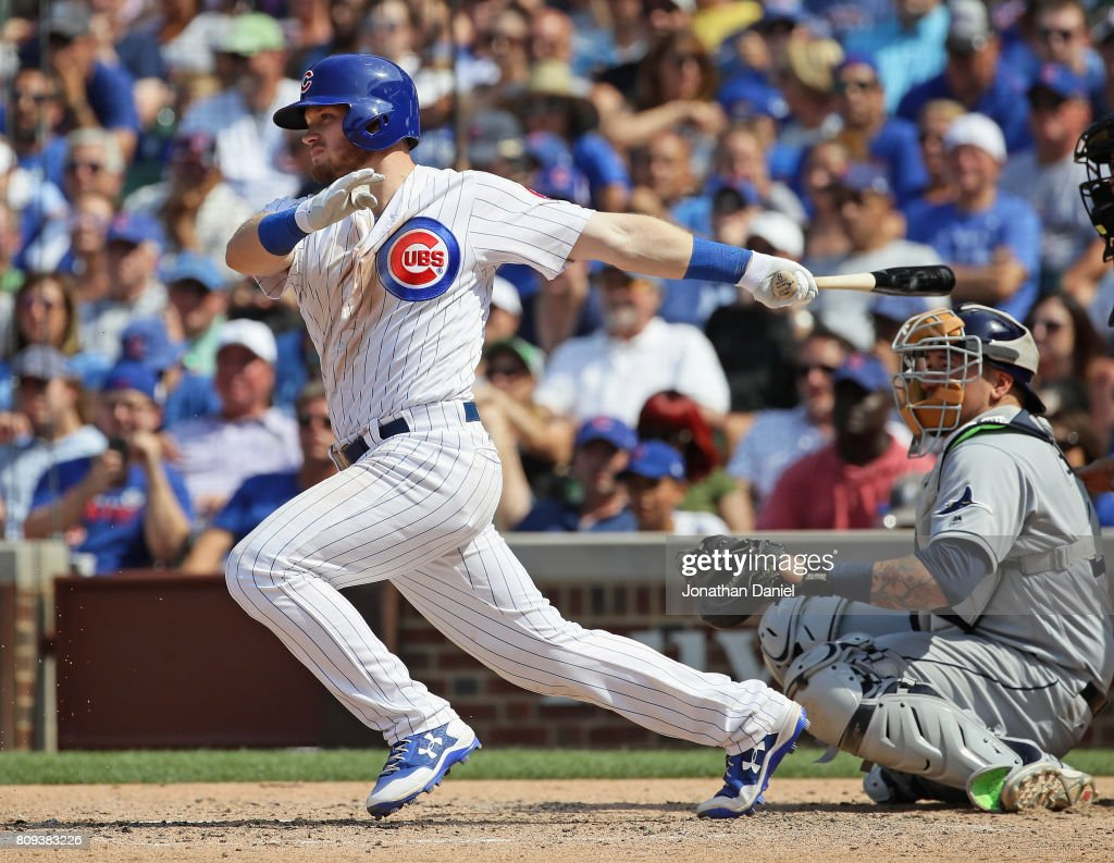 Ian Happ #8 of the Chicago Cubs hits a two run single in the 7th inning against the Tampa Bay Rays at Wrigley Field on July 5, 2017 in Chicago, Illinois.