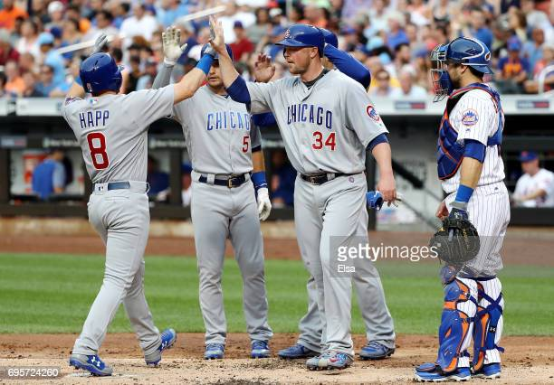 Ian Happ of the Chicago Cubs is congratulated by teammates Albert Almora Jr #5Anthony Rizzo and Jon Lester after Happ drove them all home with a...