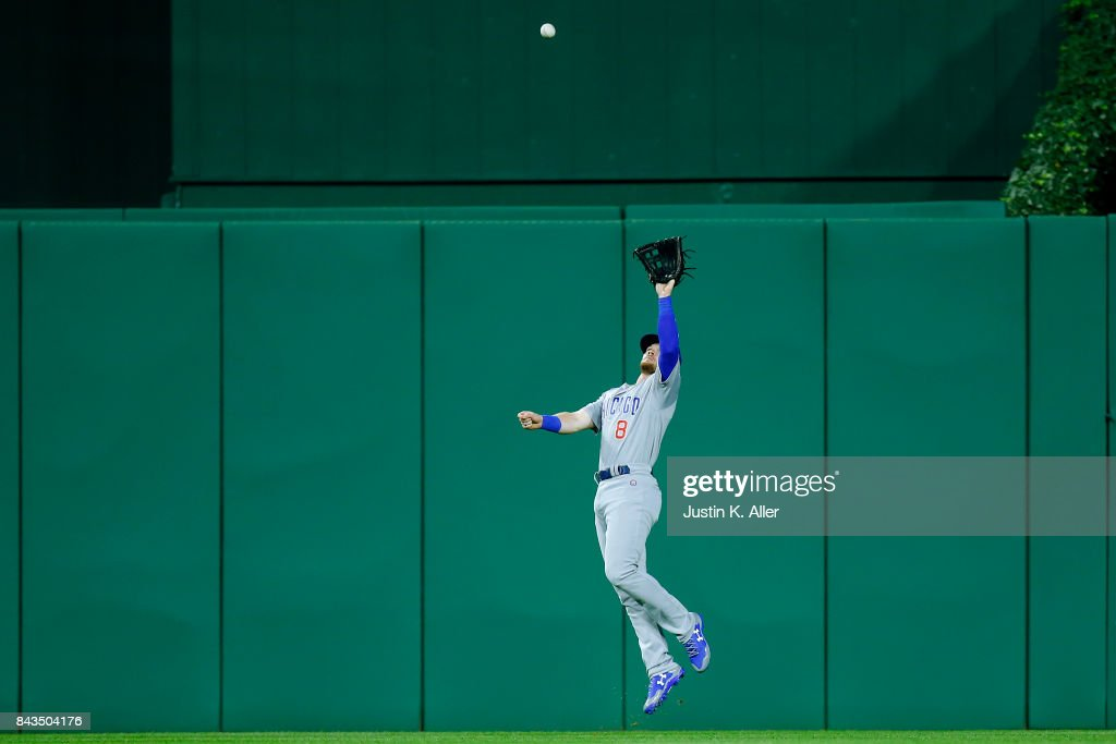 Ian Happ #8 of the Chicago Cubs makes a catch in the third inning against the Pittsburgh Pirates at PNC Park on September 6, 2017 in Pittsburgh, Pennsylvania.