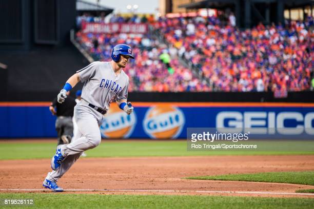 Ian Happ of the Chicago Cubs rounds the bases after hitting a grand slam home run during the game against the New York Mets at Citi Field on June 13...