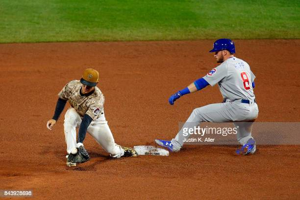 Ian Happ of the Chicago Cubs slides into a double against Max Moroff of the Pittsburgh Pirates at PNC Park on September 7 2017 in Pittsburgh...