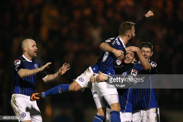 Ian Henderson of Rochdale AFC celebrates his goal with team mates during the Budweiser FA Cup third round match between Rochdale and Leeds United at...