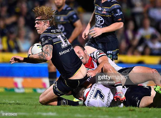 Ian Henderson of the Roosters has his lower leg broken whilst trying to tackle Ethan Lowe of the Cowboys during the round three NRL match between the...