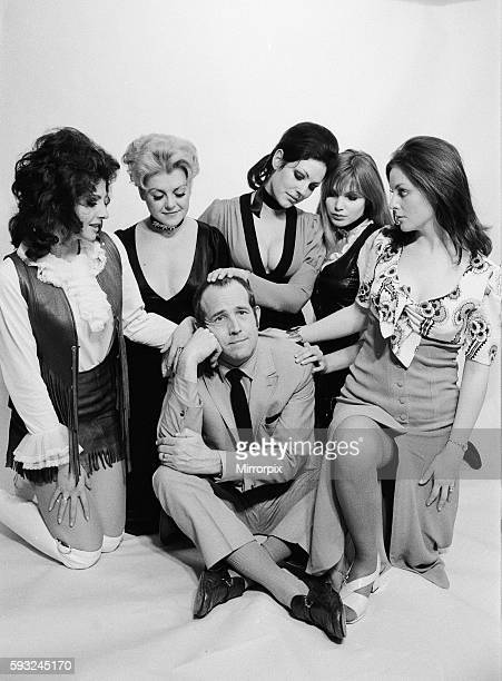 Ian Hendy who plays Don Quick pictured surrounded by some of the girls in the series left to right Vikki Woolf Gay Soper Anna Brett Madeline Smith...