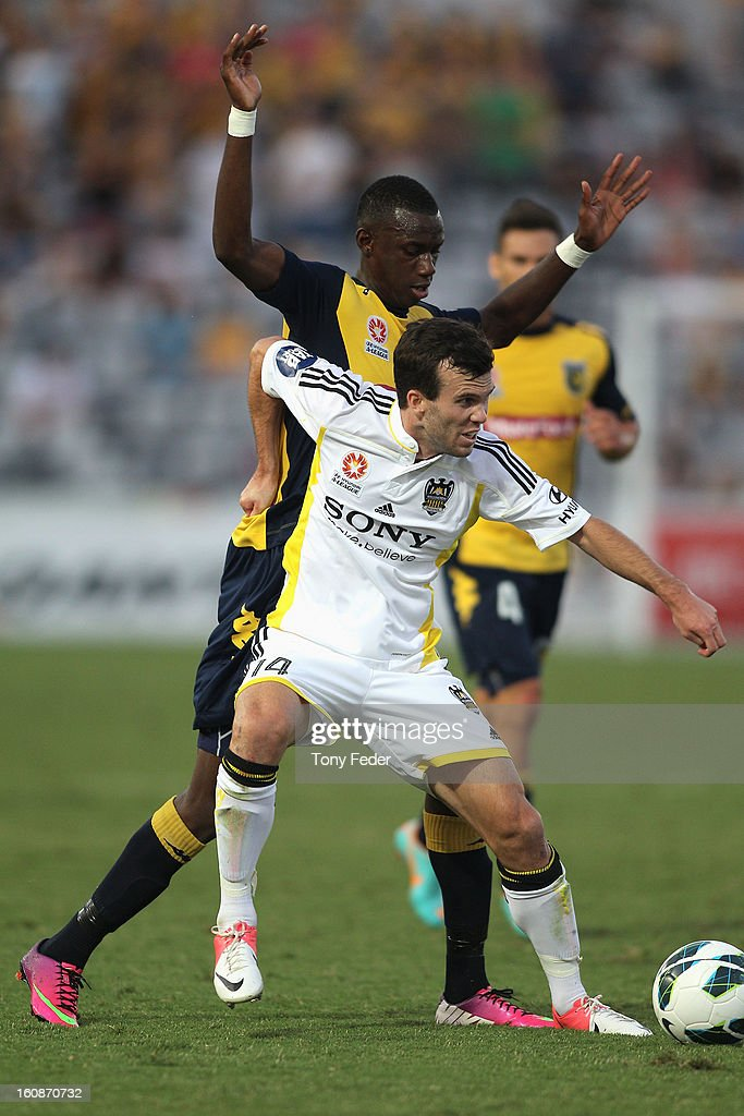 Ian Hogg of the Phoenix is pressured by Bernie Ibini of the Mariners during the round 20 A-League match between the Central Coast Mariners and the Wellington Phoenix at Bluetongue Stadium on February 7, 2013 in Gosford, Australia.