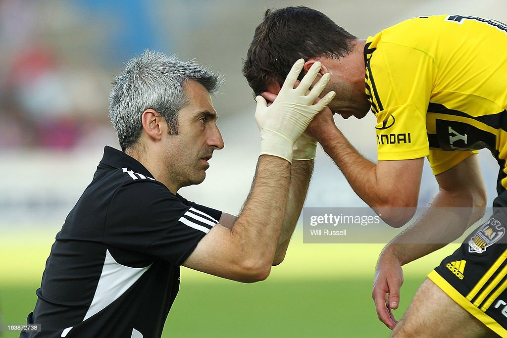 Ian Hogg of the Wellington Phoenix is checked by a trainer after bumping his head during the round 25 A-League match between the Perth Glory and the Wellington Phoenix at nib Stadium on March 17, 2013 in Perth, Australia.