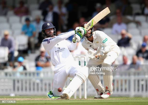 Ian Holland of Hampshire in action during day two of the Specsavers County Championship Division One match between Surrey and Hampshire at The Kia...