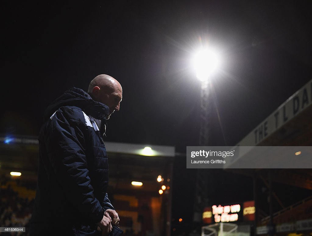 <a gi-track='captionPersonalityLinkClicked' href=/galleries/search?phrase=Ian+Holloway&family=editorial&specificpeople=235580 ng-click='$event.stopPropagation()'>Ian Holloway</a> of Millwall trudges off the field after defeat in the FA Cup Third Round Replay between Bradford City and Millwall at Coral Windows Stadium, Valley Parade on January 14, 2015 in Bradford, England.