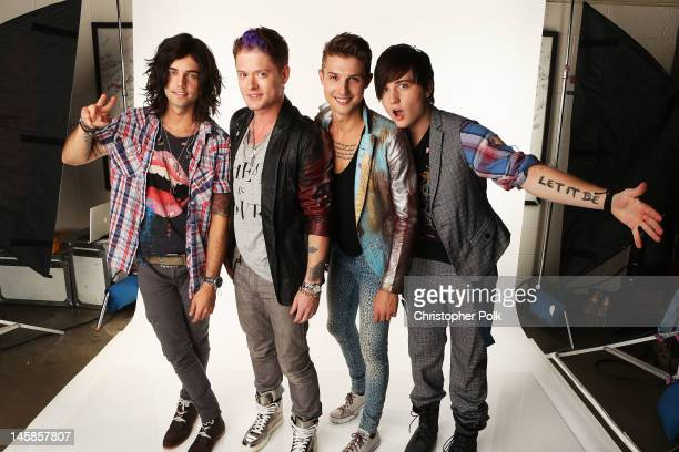 Ian Keaggy Nash Overstreet Ryan Follese and Jamie Follese of Hot Chelle Rae pose in the Wonderwallcomcom Portrait Studio during 2012 CMT Music awards...