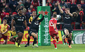 Ian Keatley of Munster drops a goal during the European Rugby Champions Cup match between Munster and Saracens at Thomond Park on October 24 2014 in...