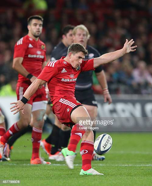 Ian Keatley of Munster kicks the ball upfield during the European Rugby Champions Cup match between Munster and Saracens at Thomond Park on October...