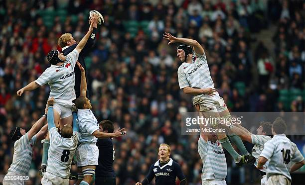 Ian Kench of Oxford jumps in the line out with Martin Wilson and Daniel Vickerman of Cambridge during the Varsity Rugby Match between Oxford...