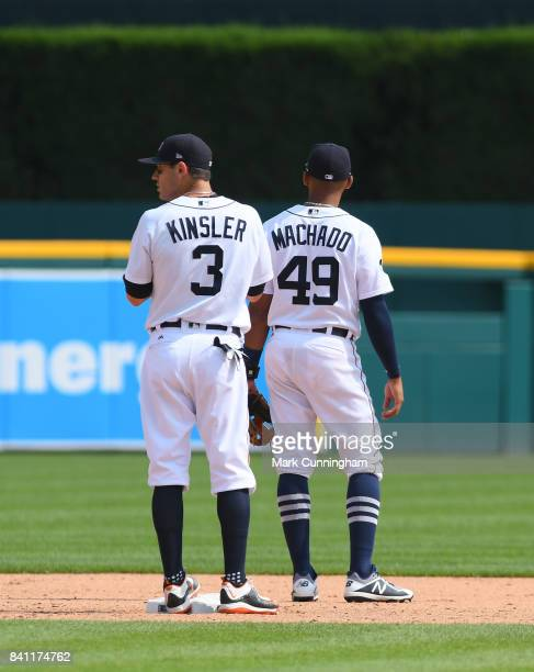Ian Kinsler and Dixon Machado of the Detroit Tigers stand together on the field during the game against the Los Angeles Dodgers at Comerica Park on...