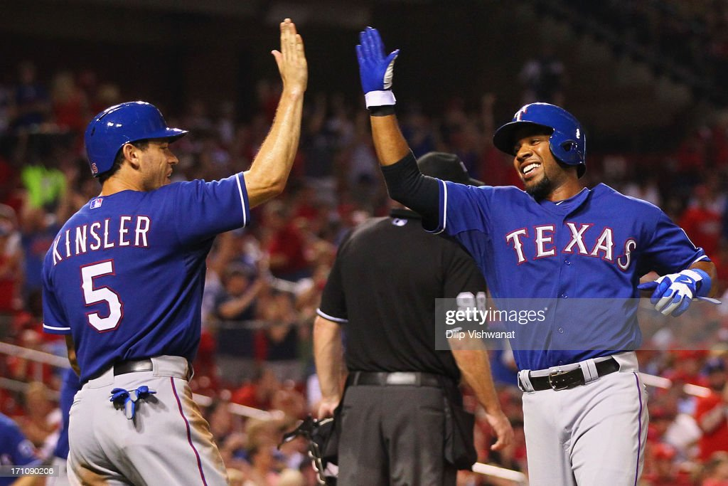 Ian Kinsler and Elvis Andrus both of the Texas Rangers congratulate each other after scoring the gamewinning runs against the St Louis Cardinals in...