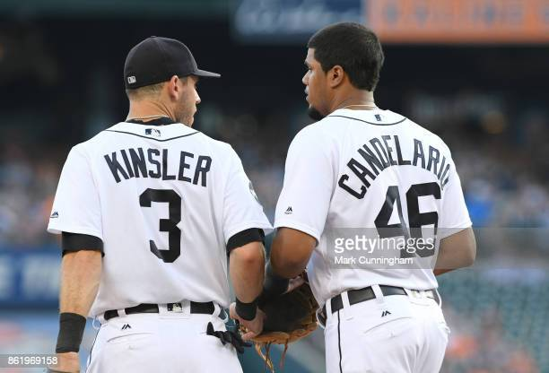 Ian Kinsler and Jeimer Candelario of the Detroit Tigers walk together on the field during the game against the Minnesota Twins at Comerica Park on...