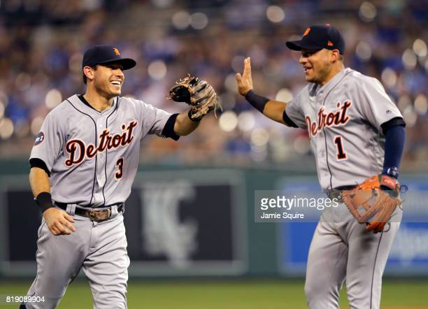 Ian Kinsler and Jose Iglesias of the Detroit Tigers congratulate each other after picking off a runner on second base to end the top of the 6th...