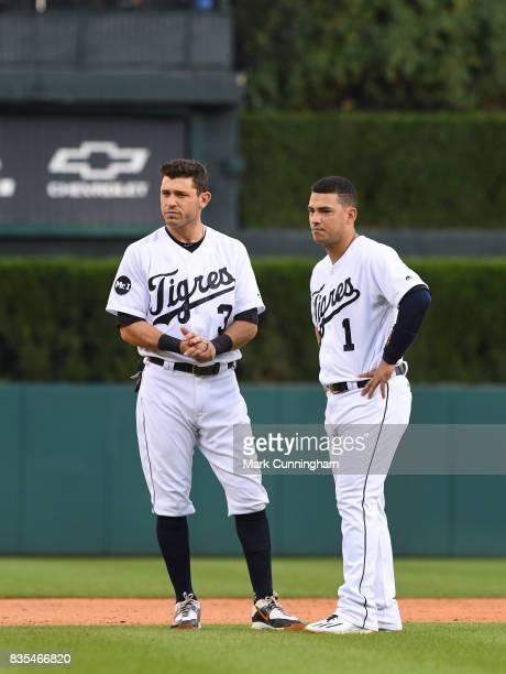 Ian Kinsler and Jose Iglesias of the Detroit Tigers stand together on the field while wearing special jerseys to honor the ¡Fiesta Tigres celebration...