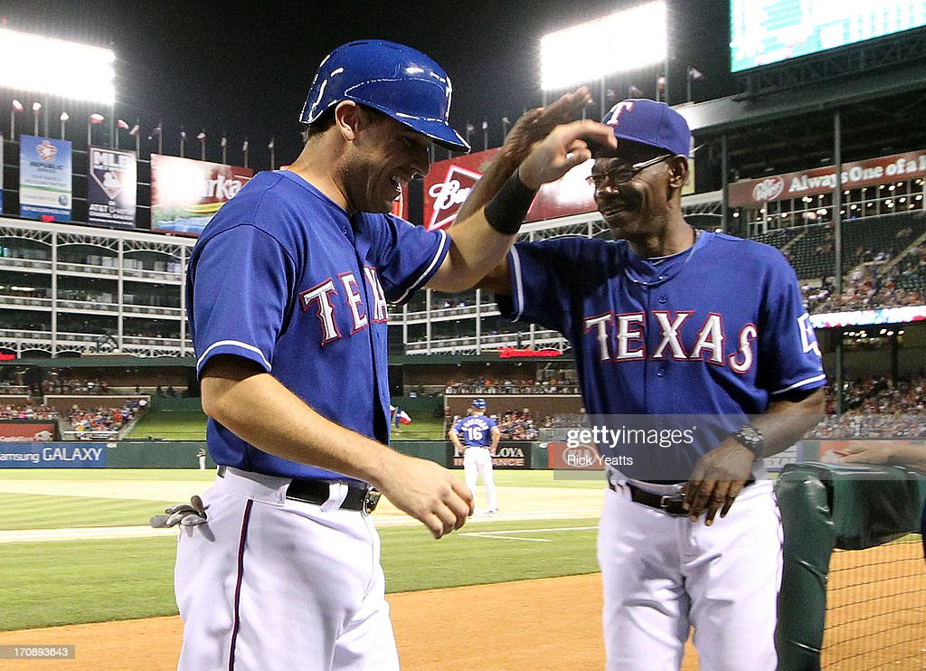 <a gi-track='captionPersonalityLinkClicked' href=/galleries/search?phrase=Ian+Kinsler&family=editorial&specificpeople=538104 ng-click='$event.stopPropagation()'>Ian Kinsler</a> #5 is congratulated by <a gi-track='captionPersonalityLinkClicked' href=/galleries/search?phrase=Ron+Washington&family=editorial&specificpeople=225012 ng-click='$event.stopPropagation()'>Ron Washington</a> #38 of the Texas Rangers for scoring against the Oakland Athletics on a double RBI by Adrian Beltre #29 at Rangers Ballpark in Arlington on June 19, 2013 in Arlington, Texas.