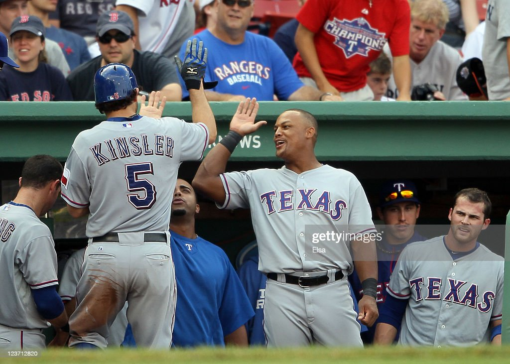 <a gi-track='captionPersonalityLinkClicked' href=/galleries/search?phrase=Ian+Kinsler&family=editorial&specificpeople=538104 ng-click='$event.stopPropagation()'>Ian Kinsler</a> #5 is congratulated by teammate <a gi-track='captionPersonalityLinkClicked' href=/galleries/search?phrase=Adrian+Beltre&family=editorial&specificpeople=202631 ng-click='$event.stopPropagation()'>Adrian Beltre</a> #29 of the Texas Rangers after Kinsler hit a solo home run in the ninth inning against the Boston Red Sox on September 4, 2011 at Fenway Park in Boston, Massachusetts.