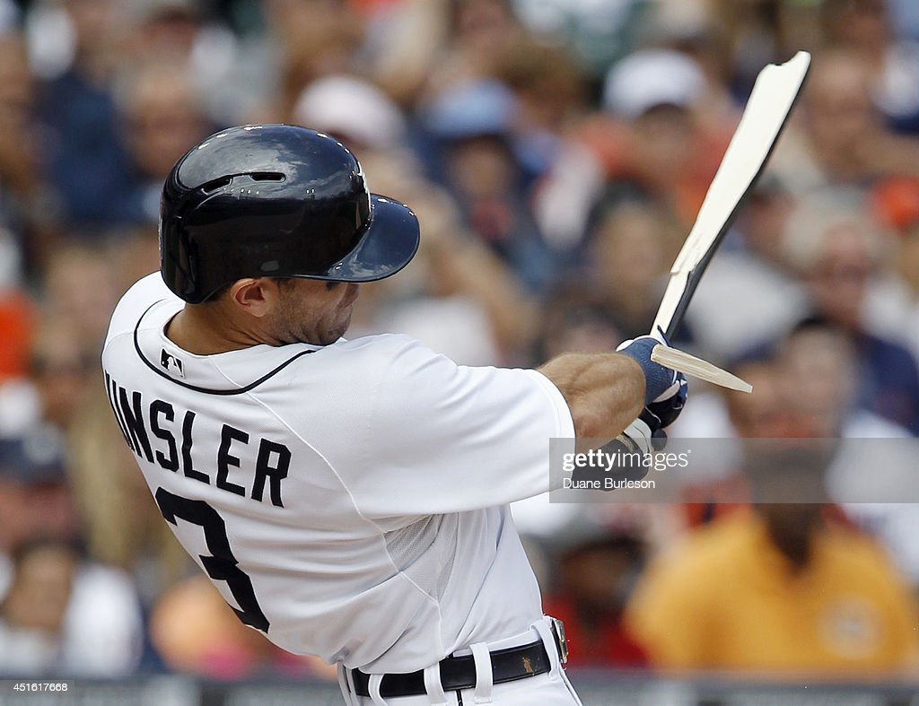 Ian Kinsler of the Detroit Tigers breaks his bat hitting a RBIsingle during the sixth inning to drive in Rajai Davis against the Oakland Athletics at...