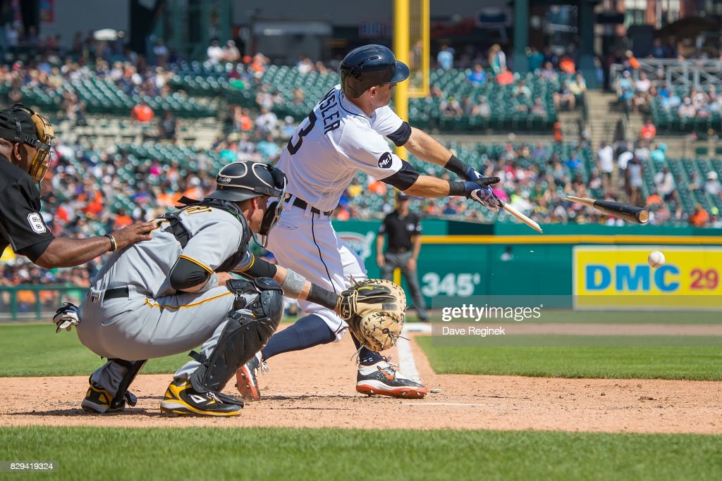 Ian Kinsler #3 of the Detroit Tigers breaks his bat in the eighth inning against the Pittsburgh Pirates during a MLB game at Comerica Park on August 10, 2017 in Detroit, Michigan. The Pirates defeated the Tigers 7-5.