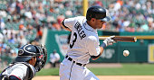 Ian Kinsler of the Detroit Tigers bunts for an infield single during the sixth inning of the game against the Minnesota Twins on July 20 2016 at...