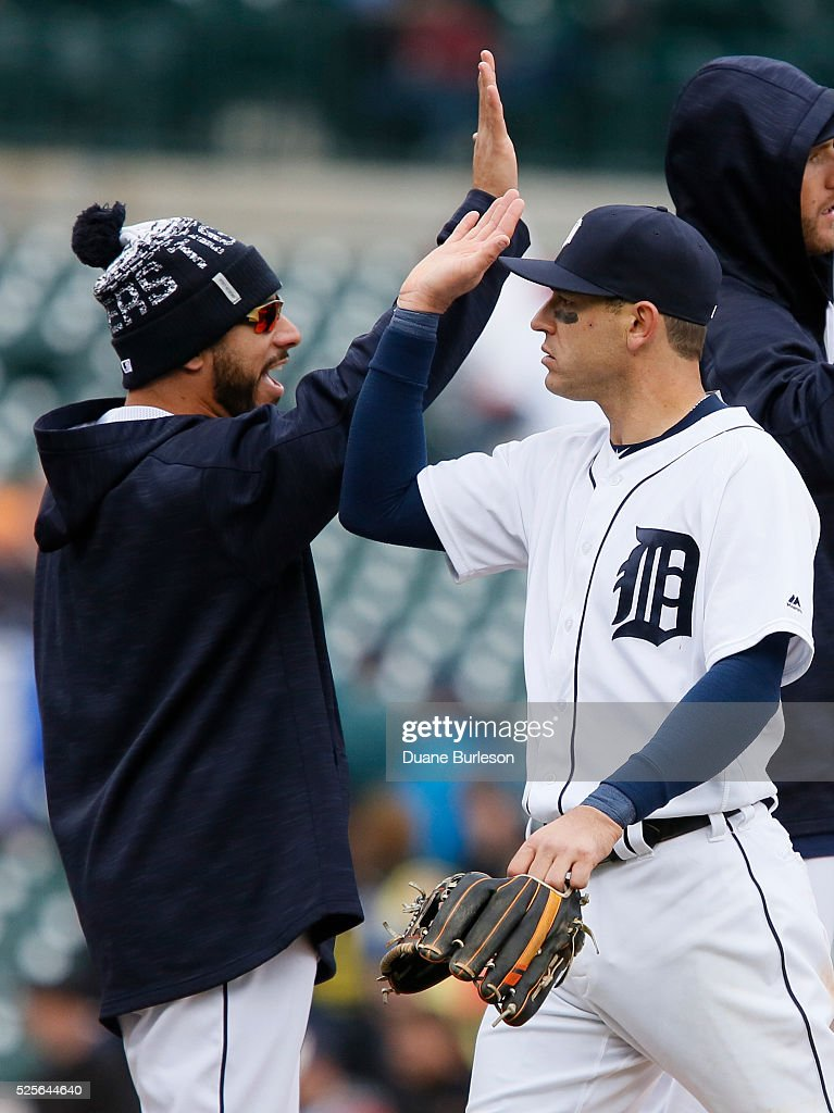 Ian Kinsler #3 of the Detroit Tigers celebrates with Mike Aviles #14 after a 7-3 win over the Oakland Athletic at Comerica Park on April 28, 2016 in Detroit, Michigan.
