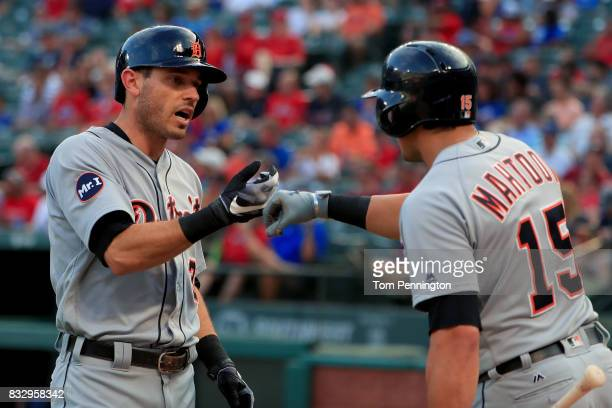 Ian Kinsler of the Detroit Tigers celebrates with Mikie Mahtook of the Detroit Tigers after hitting a solo home run against the Texas Rangers in the...