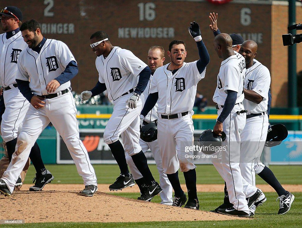 Ian Kinsler of the Detroit Tigers celebrates with teammates after his 10th inning game winning single to beat the Kansas City Royals 21 at Comerica...
