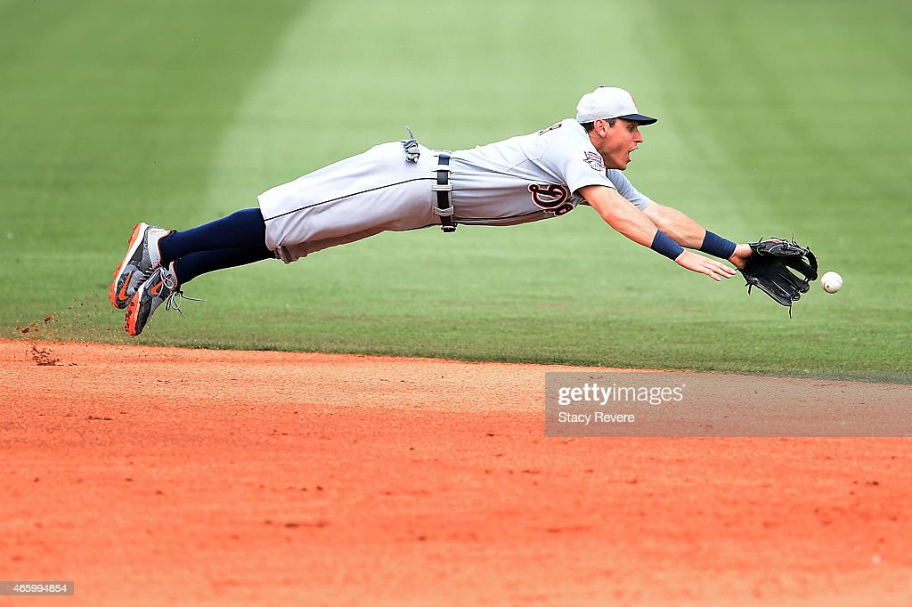 Ian Kinsler of the Detroit Tigers dives for a ground ball during the fifth inning of a spring training game against the Houston Astros at Osceola...