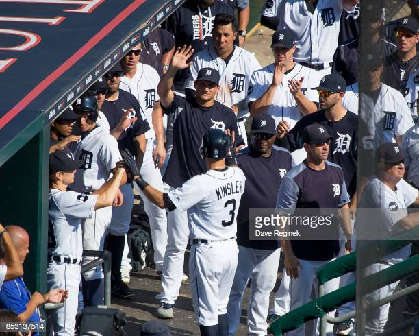 Ian Kinsler of the Detroit Tigers hifives teammates in the dugout after hitting a two run home run in the ninth inning against the Minnesota Twins...