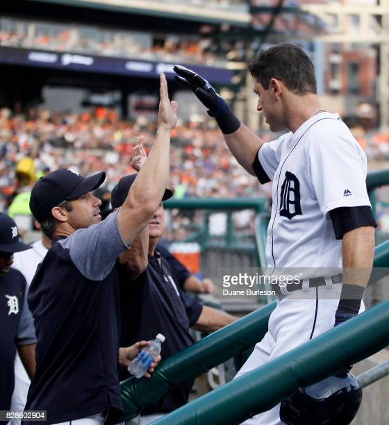 Ian Kinsler of the Detroit Tigers is congratulated by manager Brad Ausmus of the Detroit Tigers after hitting a solo home run against the Pittsburgh...
