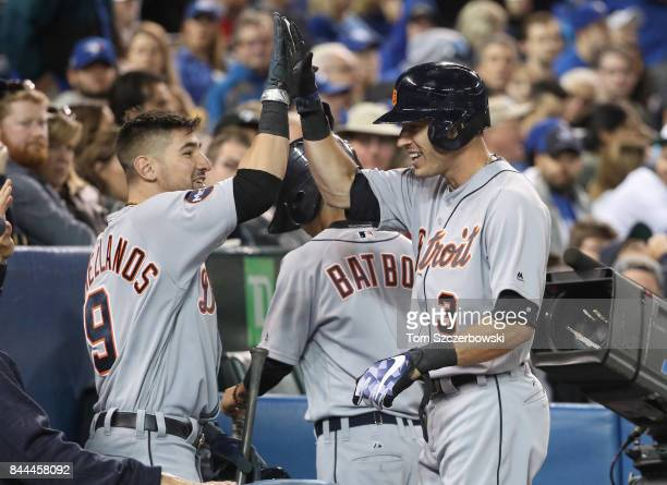 Ian Kinsler of the Detroit Tigers is congratulated by Nick Castellanos after hitting a solo home run in the seventh inning during MLB game action...