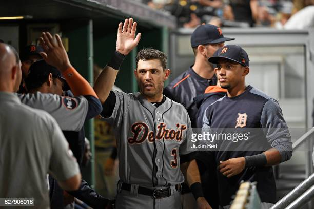 Ian Kinsler of the Detroit Tigers is met by teammates in the dugout after coming around to score on an RBI double by Jim Aducci in the sixth inning...