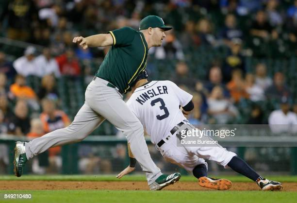 Ian Kinsler of the Detroit Tigers is tagged out by pitcher Liam Hendriks of the Oakland Athletics after getting caught in a rundown between second...