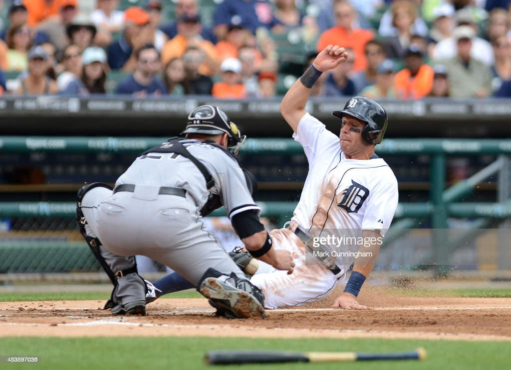 <a gi-track='captionPersonalityLinkClicked' href=/galleries/search?phrase=Ian+Kinsler&family=editorial&specificpeople=538104 ng-click='$event.stopPropagation()'>Ian Kinsler</a> #3 of the Detroit Tigers is tagged out on a play at home plate by <a gi-track='captionPersonalityLinkClicked' href=/galleries/search?phrase=Tyler+Flowers&family=editorial&specificpeople=4217244 ng-click='$event.stopPropagation()'>Tyler Flowers</a> #21 of the Chicago White Sox during the game at Comerica Park on July 31, 2014 in Detroit, Michigan. The White Sox defeated the Tigers 7-4.