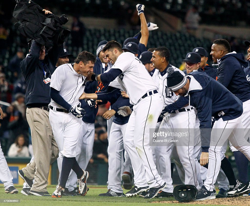 <a gi-track='captionPersonalityLinkClicked' href=/galleries/search?phrase=Ian+Kinsler&family=editorial&specificpeople=538104 ng-click='$event.stopPropagation()'>Ian Kinsler</a> #3 of the Detroit Tigers, left, celebrates with <a gi-track='captionPersonalityLinkClicked' href=/galleries/search?phrase=J.D.+Martinez&family=editorial&specificpeople=7520024 ng-click='$event.stopPropagation()'>J.D. Martinez</a> #28 of the Detroit Tigers and teammates after hitting a walk-off single in the 10th inning that scored <a gi-track='captionPersonalityLinkClicked' href=/galleries/search?phrase=Anthony+Gose&family=editorial&specificpeople=6906091 ng-click='$event.stopPropagation()'>Anthony Gose</a> to defeat the Minnesota Twins 2-1 at Comerica Park on May 12, 2015 in Detroit, Michigan.