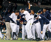 Ian Kinsler of the Detroit Tigers left celebrates with JD Martinez of the Detroit Tigers and teammates after hitting a walkoff single in the 10th...
