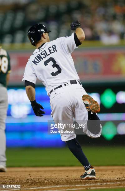 Ian Kinsler of the Detroit Tigers rounds first base after hitting a solo home run against the Oakland Athletics during the third inning at Comerica...