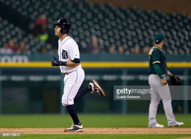 Ian Kinsler of the Detroit Tigers rounds the bases after hitting a solo home run against the Oakland Athletics during the third inning at Comerica...