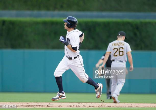 Ian Kinsler of the Detroit Tigers rounds the bases past Adam Frazier of the Pittsburgh Pirates after hitting a home run during an interleague game at...