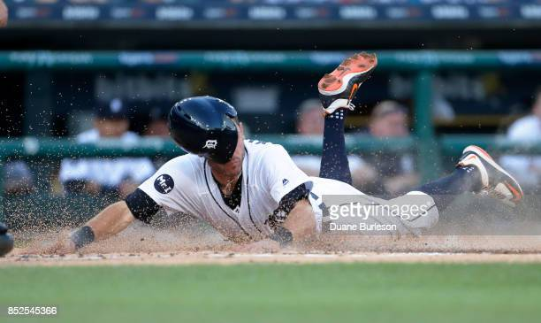 Ian Kinsler of the Detroit Tigers scores against the Minnesota Twins from second base on a single by Alex Presley of the Detroit Tigers during the...