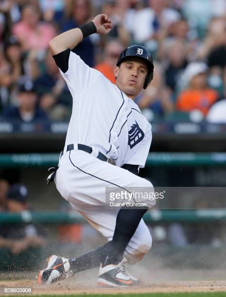 Ian Kinsler of the Detroit Tigers scores against the Pittsburgh Pirates from second base on a single by Nicholas Castellanos of the Detroit Tigers...