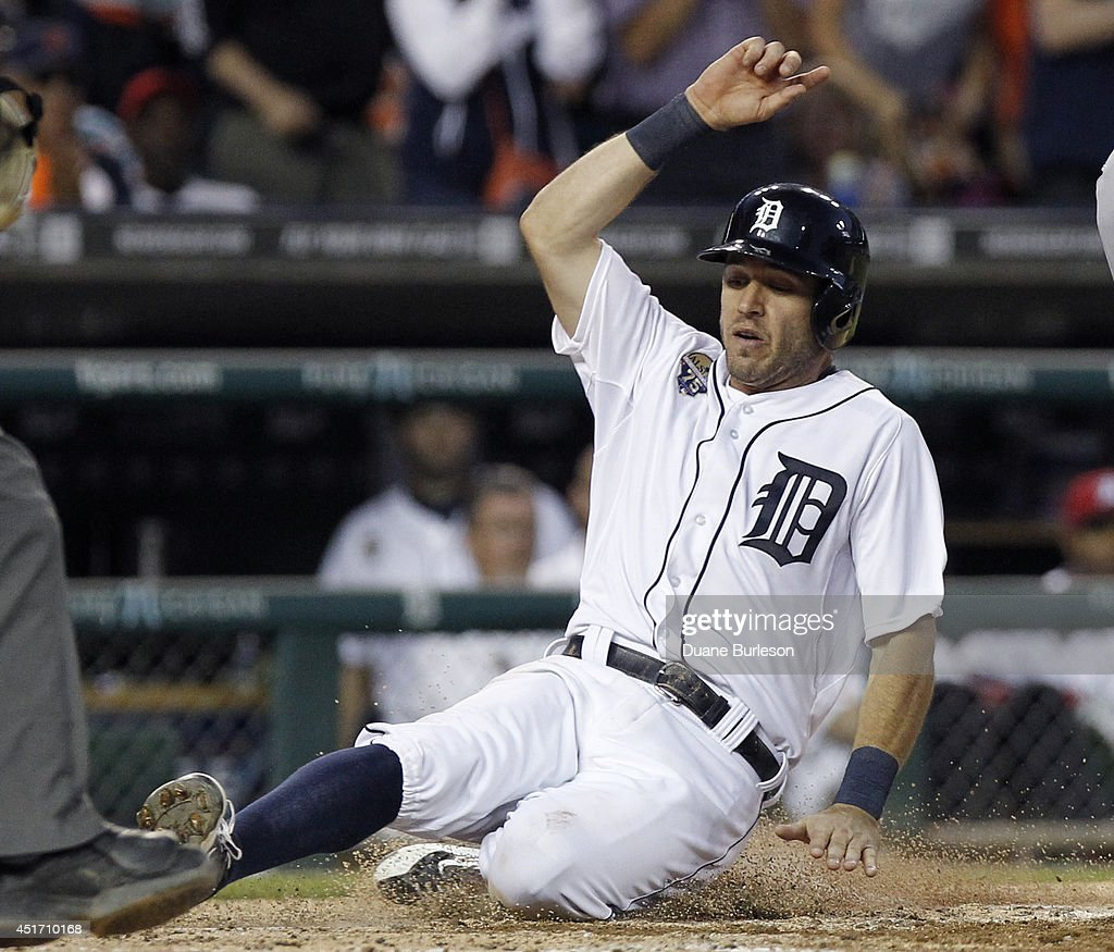 <a gi-track='captionPersonalityLinkClicked' href=/galleries/search?phrase=Ian+Kinsler&family=editorial&specificpeople=538104 ng-click='$event.stopPropagation()'>Ian Kinsler</a> #3 of the Detroit Tigers scores against the Tampa Bay Rays on a single by Victor Martinez during the sixth inning at Comerica Park on July 4, 2014 in Detroit, Michigan.