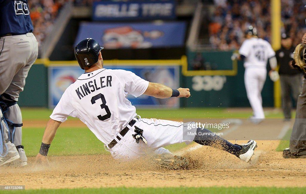 Ian Kinsler #3 of the Detroit Tigers slides safely into home during the game against the Tampa Bay Rays at Comerica Park on July 4, 2014 in Detroit, Michigan. The Rays defeated the Tigers 6-3.