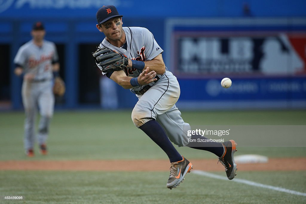 Ian Kinsler #3 of the Detroit Tigers throws out the baserunner in the eighteenth inning during MLB game action against the Toronto Blue Jays on August 10, 2014 at Rogers Centre in Toronto, Ontario, Canada.