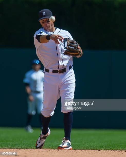 Ian Kinsler of the Detroit Tigers throws the ball to first base during a MLB game against the Pittsburgh Pirates at Comerica Park on August 10 2017...